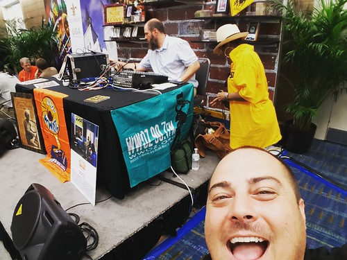 Michael Liuzza photobombs the WWOZ booth at IPW 2016