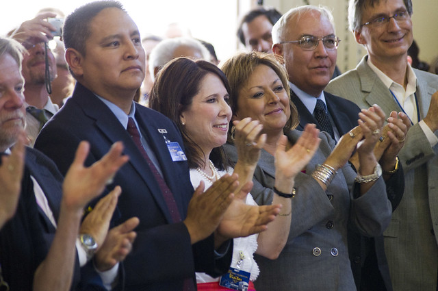 New Mexico Governor Susana Martinez and other dignitaries applaud as the 1,014th shipment of transuranic waste leaves Los Alamos National Laboratory.  Photo by Tanner Johnson.