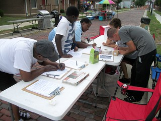 Member Kyle Randall signing in people to Liberty Row Block Party and helping register voters.