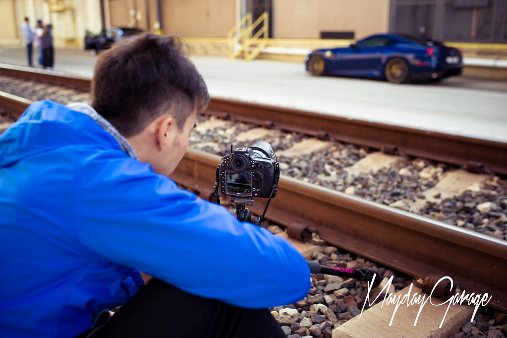 John sets up the shot for Safeer's Ferrari on ADV.1's.
