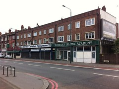 The end of a block of terraced shops running in from the left.  Norbury Islamic Academy is on the very end, with Devons Catering Equipment next to it.