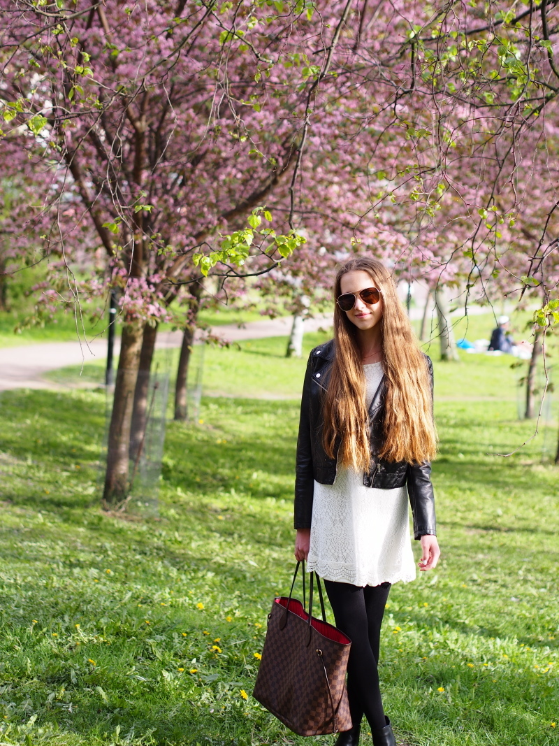 White lace dress, black leather jacket and tights, black booties and Neverfull bag