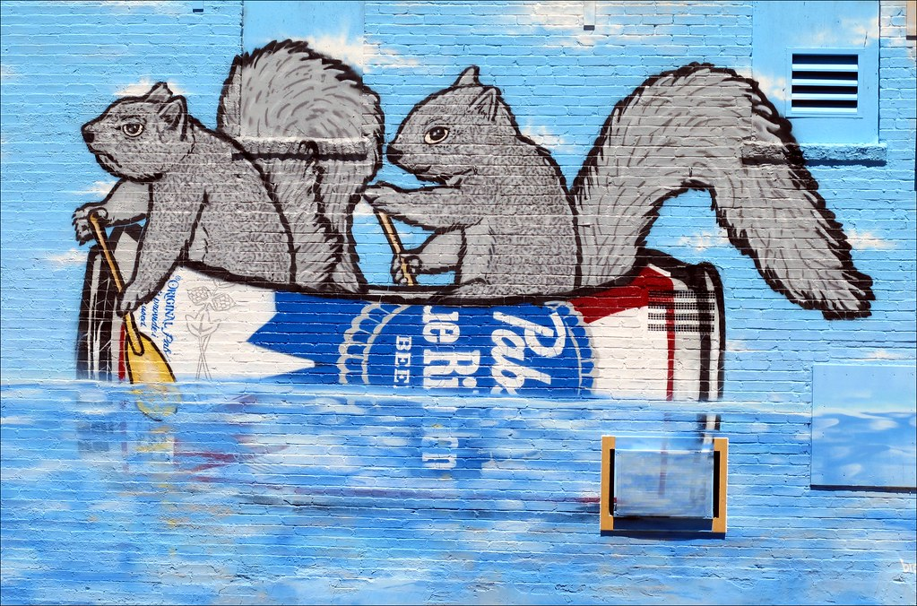 Squirrels canoeing in a pbr can