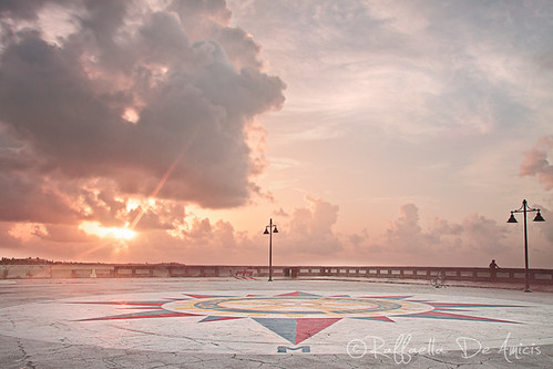 sunrise dawn morning clouds drama compass compassrose red yellow blue orange pink pier whitestreetpier keywest floridakeys italianamericanphotographer travelphotography travelart raffaelladeamicis dawninkeywest sunriseatwhitestreetpier concrete sun stormy