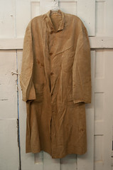 fur(0.0), wool(0.0), leather(0.0), jacket(0.0), trench coat(0.0), pattern(1.0), textile(1.0), brown(1.0), clothing(1.0), khaki(1.0), outerwear(1.0), overcoat(1.0), beige(1.0), coat(1.0),