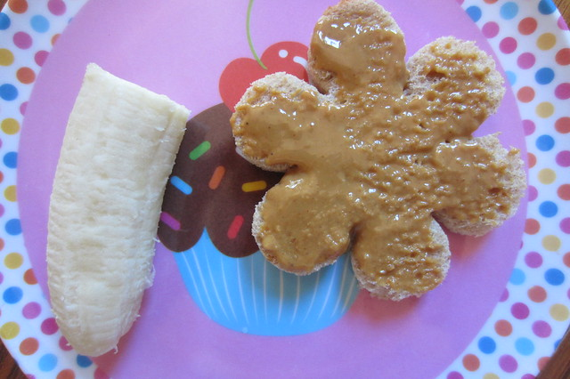 Addy eats: flower shaped toast with peanut butter and 1/2 a banana