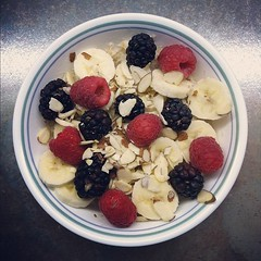 Oatmeal with raspberries, blackberries, bananas, and almonds. #breakfast #fruit #food #foodporn