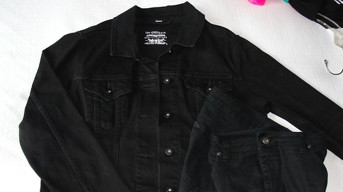 A black denim jacket and black jeans after over-dyeing with Blackest Black dye