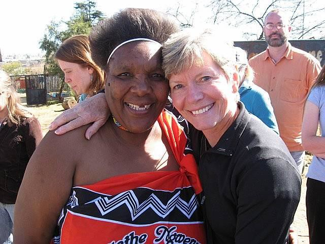 Pam Mfaxa and Bryn Mawr Presbyterian Church Choir Tour Manager Dianne Giombetti in Soweto