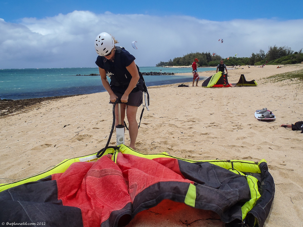 travel bloggers Dave and Deb set up kites for kiteboarding in Maui