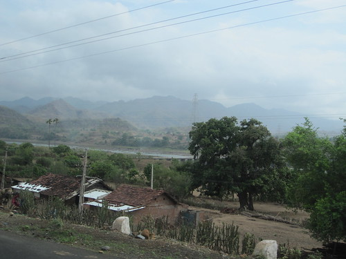 A view of Narmada, the other district that Mahila Panch and Sakhi Sangathan serve. 'Narmada' means 'river' in Gujarati and Hindi. Narmada district is home to the Narmada River, which divides northern and southern India. (The river is visible in the background.)
