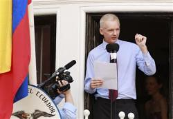 Julian Assange of WikiLeaks speaks at a press conference from the balcony of the Ecuadoran embassy in London. Assange has been granted political asylum by Ecuador. by Pan-African News Wire File Photos