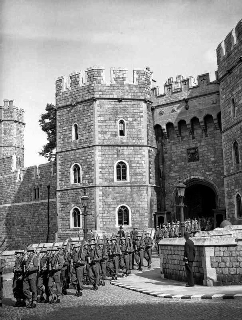 The Castle Guard, formed from members of the training battalion, Grenadier Guards, leaving the main entrance of Windsor Castle on the way to Victoria Barracks in Windsor, 30 June 1940