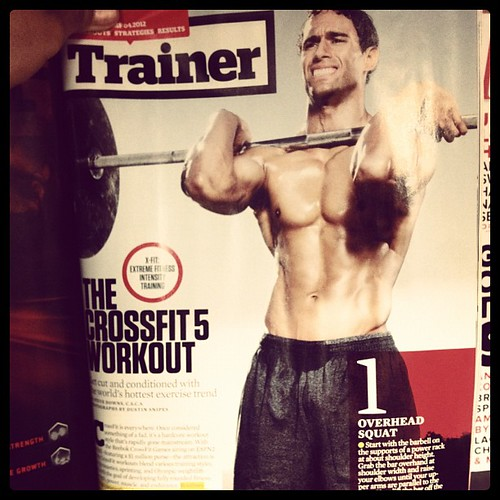 Can't believe everything you read in mags. That is most definitely not an OH squat in the April issue of Men's Fitness. Get a trainer. Learn it right, not from a piece of paper.