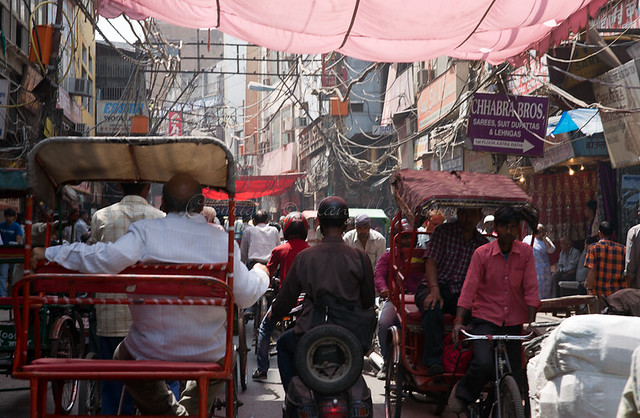 Travelling by cycle rickshaw in Delhi