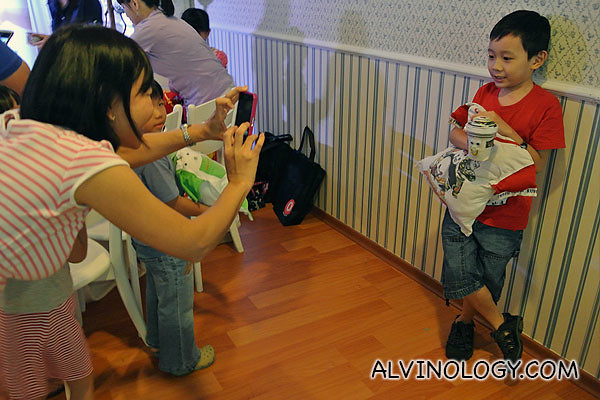 Parents got busy taking photos of their kids with their eco crafts