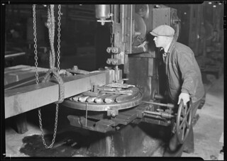 Railroad parts. Baldwin Locomotive Works. Machinist shaping a section of a driving-rod for largest locomotive, March 1937