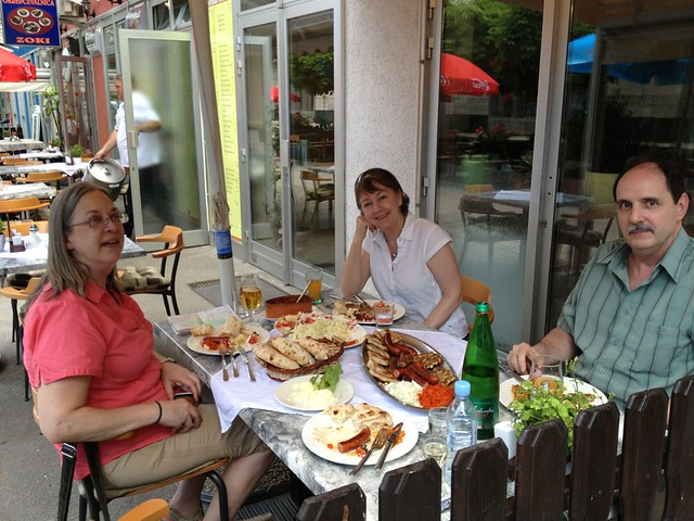 Chorus members Karla and Shelley, and Karla's husband John, enjoy lunch in Ljubljana
