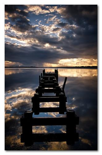 old sunrise reflections coast jetty central nsw gorokan