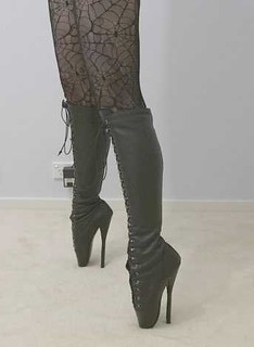 legs in stockings and stiletto boots