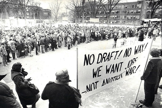 """No Draft!"" rally on Diag -- photo reversed to enhance sign's scrutability. (See adjacent photo for original view.)"