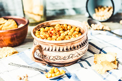 baked chickpeas with spices on rustic background,…
