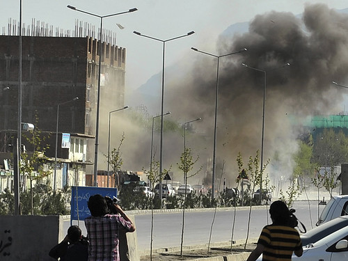 Smoke rises from the site of an attack near the Afghan parliament in Kabul April 15, 2012. Afghanistan's Taliban said they launched a spring offensive on Sunday with multiple attacks against Western embassies. by Pan-African News Wire File Photos