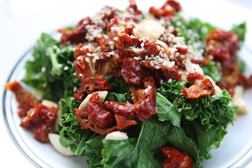 Grilled Kale Salad with Sundried Tomatoes, Almonds, and Sesame Seeds
