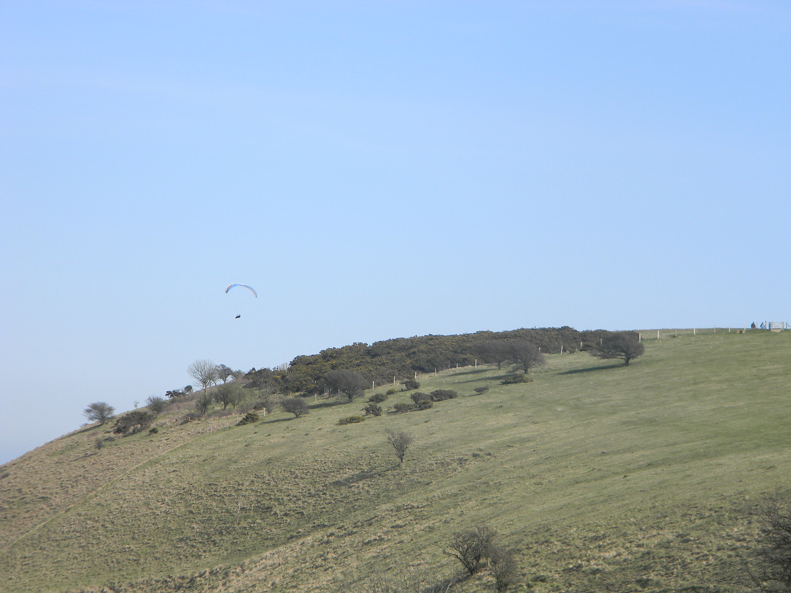 Paraglider over the summit Lewes Circular via West Firle