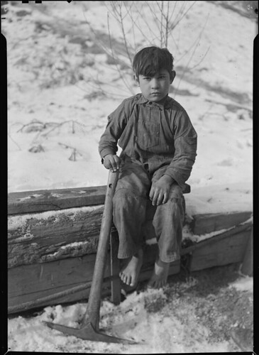 Scott's Run, West Virginia. Miner's child - This boy was digging coal from mine refuse on the road side, 1936