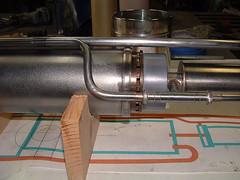 machine(0.0), wheel(0.0), weapon(0.0), firearm(0.0), gun(0.0), gun barrel(0.0), exhaust system(1.0),