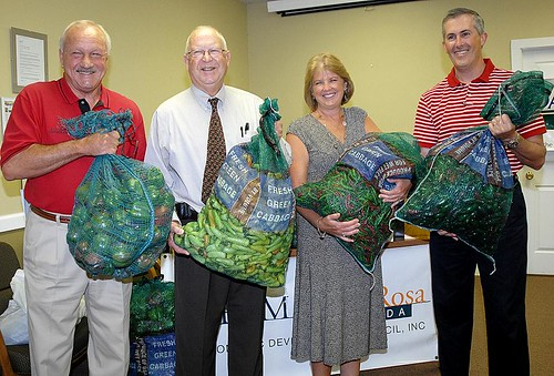Left to Right: Don Salter (TEAM Santa Rosa), Richard A. Machek (USDA Rural Development), Cindy Anderson (TEAM Santa Rosa), and Ferdinand Salomon (TEAM Santa Rosa) celebrate local farmers.