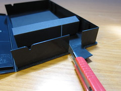 Now cut a corresponding larger opening in the case