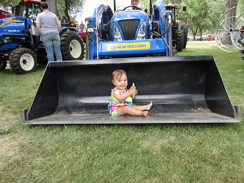 Baby in a tractor shovel