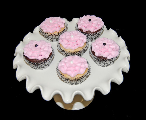 light pink and black ruffle cupcakes for a baby shower
