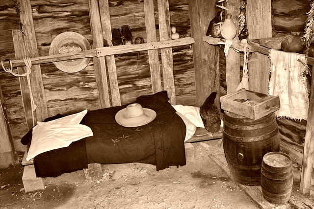 Inside colonial log cabin sleeping area at yorktown for Colonial log homes