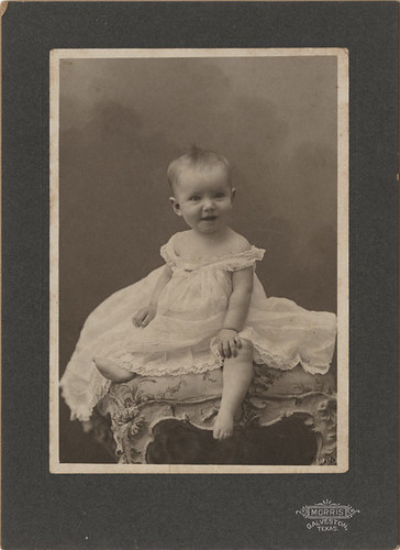 Mounted Photograph of a Smiling Baby