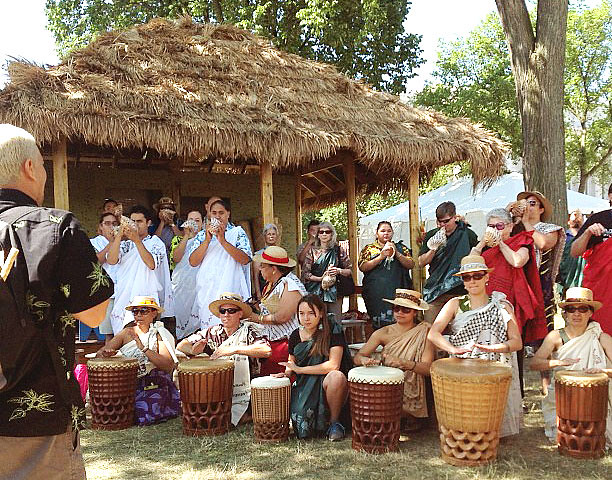 <p>University of Hawaii delegates gather before the opening ceremonies at the Smithsonian Folklife Festival on June 27.</p>