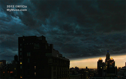 Over Union Square NYC, Con Edison Clock Tower: dark derecho cloud heads east for Brooklyn