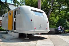 automobile(0.0), art(0.0), vehicle(0.0), transport(0.0), rolling stock(0.0), recreational vehicle(0.0), trailer(1.0), land vehicle(1.0), travel trailer(1.0),