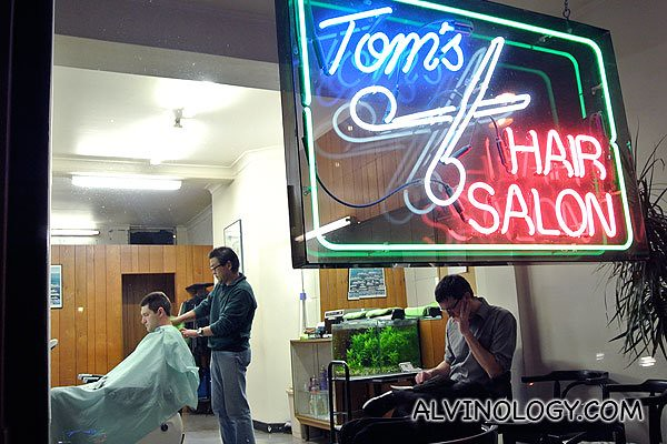 Passed by a normal barber still open at night while walking to the restaurant