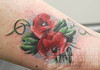 poppies on ankle tattoo
