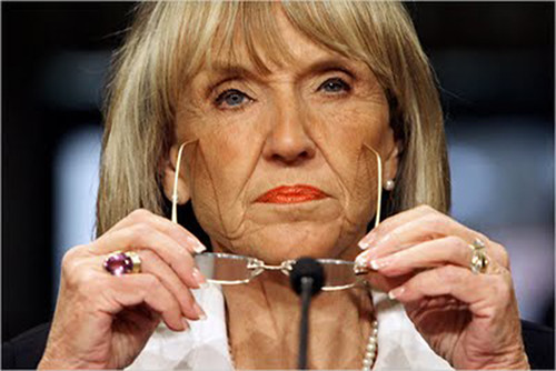 Jan Brewer squinting with her glasses on her nose