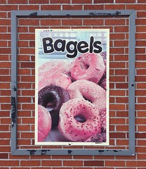 As a bagel fan, I approve of this poster. As an urban explorer, I can deal with the too-large frame against a brick wall. It's kinda pleasant. But as a graphic designer I'm really mad that this poster was laid out without bleeds, and never trimmed to its