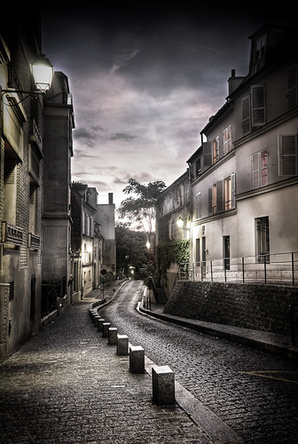 A street in montmartre at night Paris