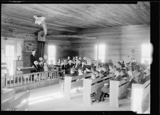 Interior view of Sharps Station M.E. Church near Loyston, Tennessee. Reverend Lovelace and some children from an orphanage conduct the Sunday afternoon service, October 1933