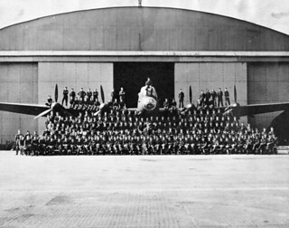 Personnel of No. 419 (Moose) Squadron, RCAF, with an Avro Lancaster B.X aircraft, Middleton St. George, England, 1944 / Membres du 419e Escadron (Moose), ARC, posant devant et sur un Avro Lancaster B.X, Middleton St. George, Angleterre, 1944