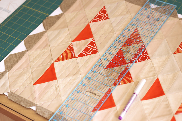 using a ruler to mark out quilting lines across the width