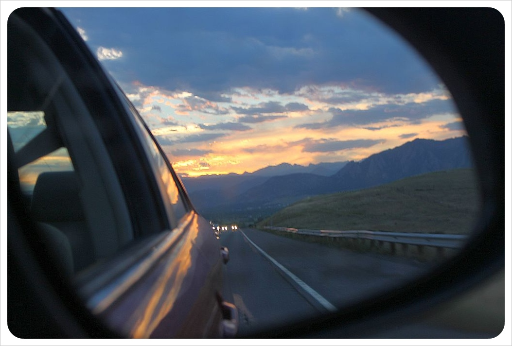rocky mountains sunset in the rearview mirror