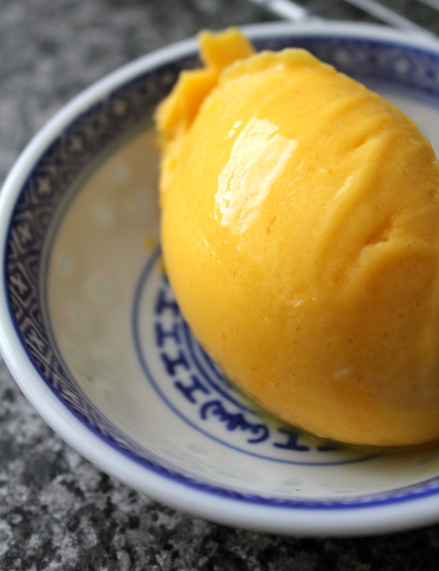 Scoop of mango gelato served in bowl
